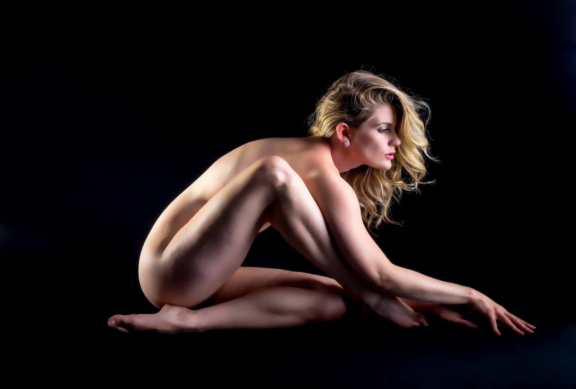 naked girl doing a pose